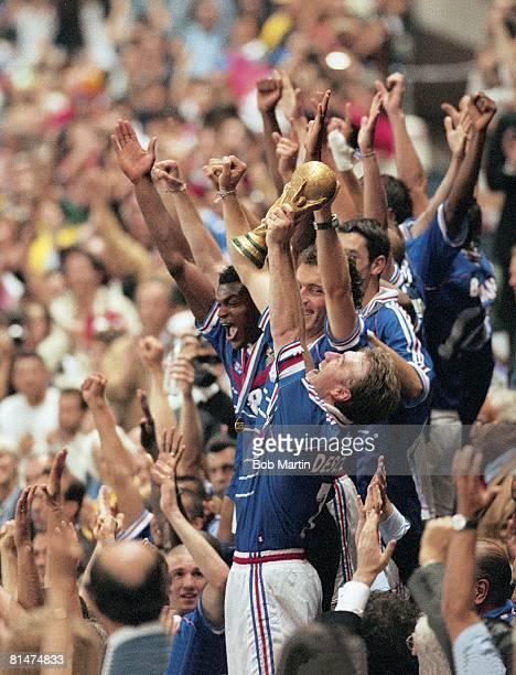 Soccer World Cup final FRA Didier Deschamps victorious with trophy and team after winning game vs Brazil at Stade de France St Denis FRA 7/12/1998