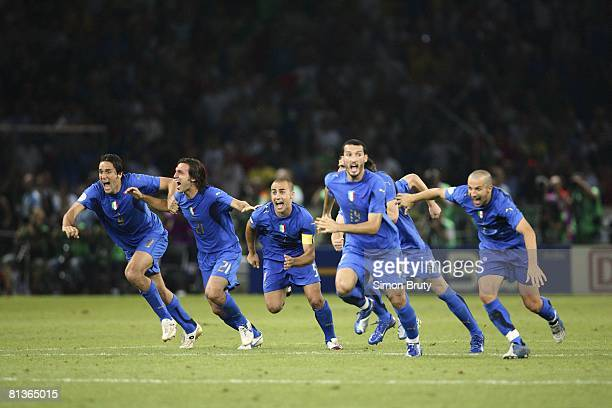 Soccer World Cup Final Team Italy Luca Toni Andrea Pirlo Fabio Cannavaro and Gianluca Zambrotta victorious after winning game from penalty kicks vs...