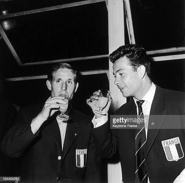 Soccer World Cup in Stockholm : the French socer players Raymond KOPA and Just FONTAINE drinking to the third rank France obtained.