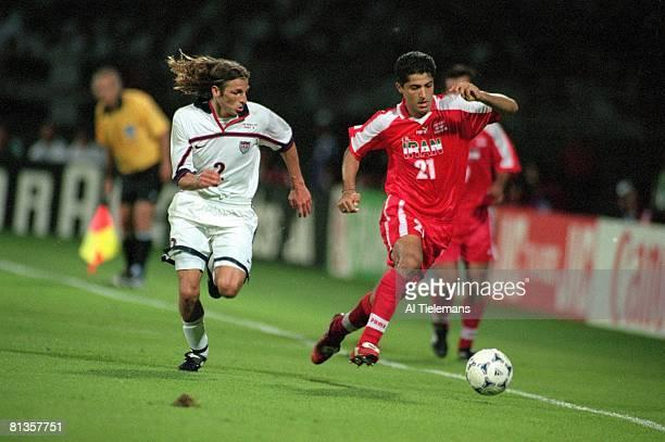 Soccer World Cup Iran Mehrdad Minavand in action vs USA Frankie Hejduk Lyon France 6/21/1998