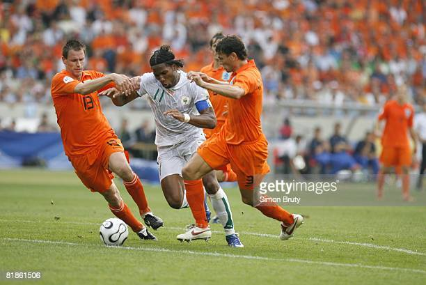Soccer World Cup Ivory Coast Didier Drogba in action vs Netherlands Andre Ooijer and Khalid Boulahrouz Stuttgart Germany 6/16/2006