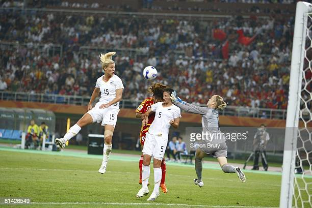 Soccer World Cup New Zealand goalie Jenny Bindon in action punching teammate Abby Erceg while trying to clear ball vs China Han Duan View of NZL Maia...