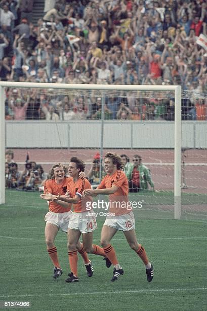 Soccer World Cup NLD Johann Cruyff victorious with teammates after scoring goal Munich FRG 6/20/1974