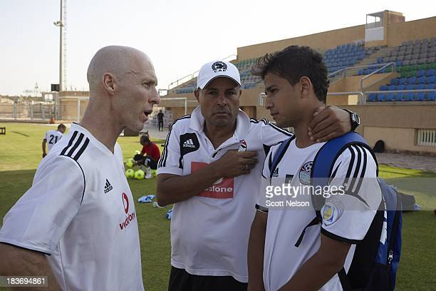 World Cup Preview Egypt coach Bob Bradley and his assistant coach Zaki AbdelFattah tell 20yearold Ahmed Refaat that did not make the roster for the...