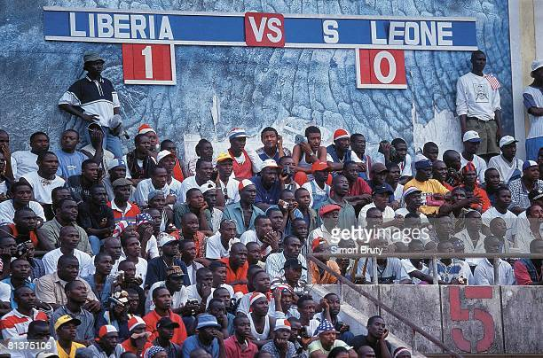 Soccer World Cup Qualifying LBR fans during match vs Sierra Leone View of scoreboard Monrovia Liberia 2/24/2001