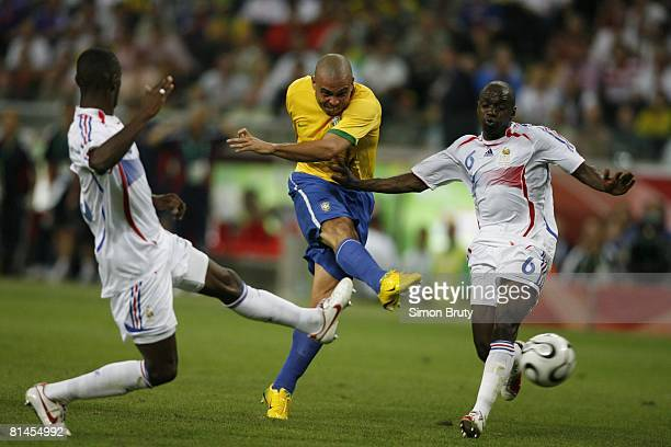 Soccer World Cup Quarterfinals Brazil Ronaldo in action taking shot vs France Claude Makelele and Eric Abidal Frankfurt Germany 7/1/2006