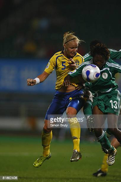 Soccer World Cup Sweden Caroline Seger in action head ball vs Nigeria Christie George Chengdu China 9/11/2007