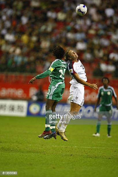 Soccer World Cup USA Abby Wambach in action head ball vs Nigeria Christie George Shanghai China 9/18/2007