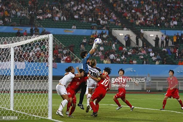 Soccer World Cup USA Abby Wambach in action vs North Korea goalie Jon Myong Hui and Ri Kum Suk Chengdu China 9/11/2007