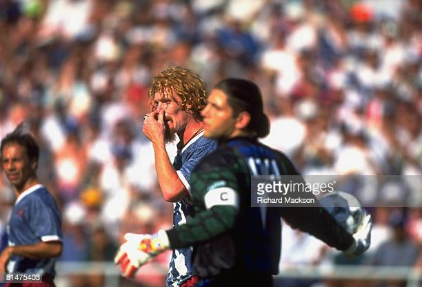 Soccer World Cup USA Alexi Lalas holding nose during game vs COL Pasadena CA 6/22/1994