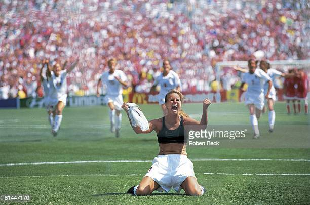 Soccer World Cup USA Brandi Chastain victorious after scoring winning penalty kick as teammates celebrate in final vs CHN Pasadena CA 7/10/1999