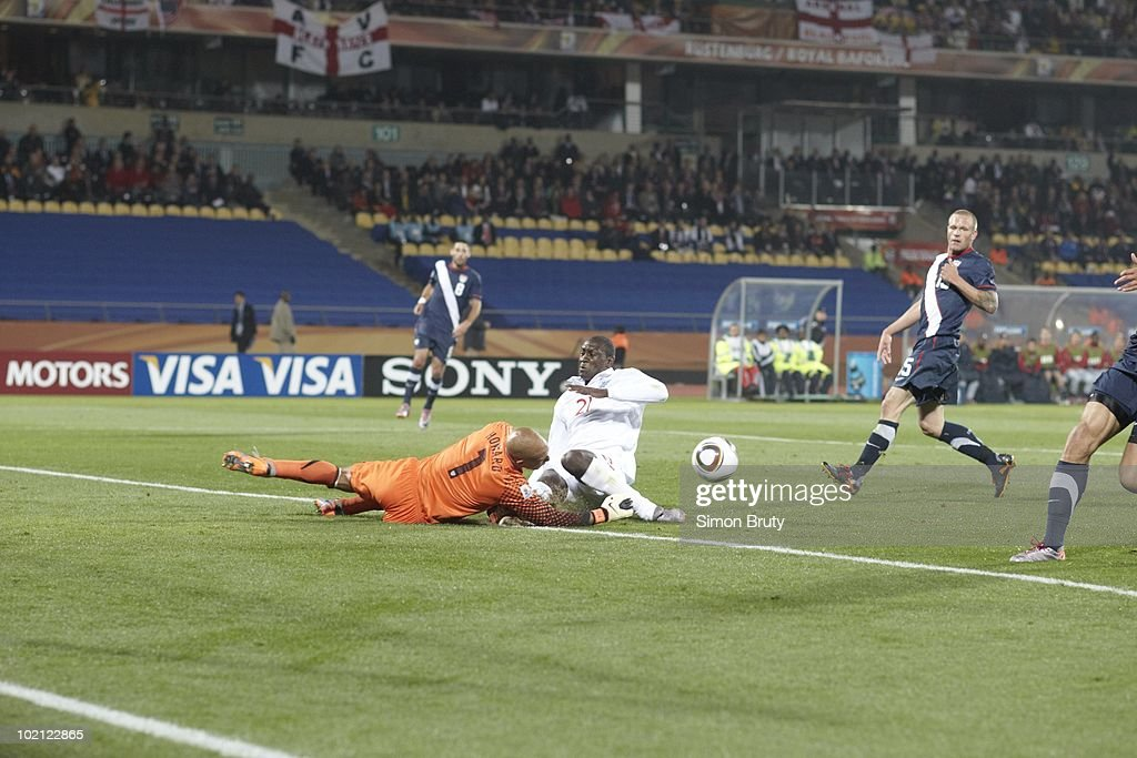 USA goalie Tim Howard (1) in action vs England Emile Heskey (21) during Group C - Match 5 at Royal Bafokeng Stadium. Howard injury from this play caused three minute stoppage. Rustenburg, South Africa 6/12/2010