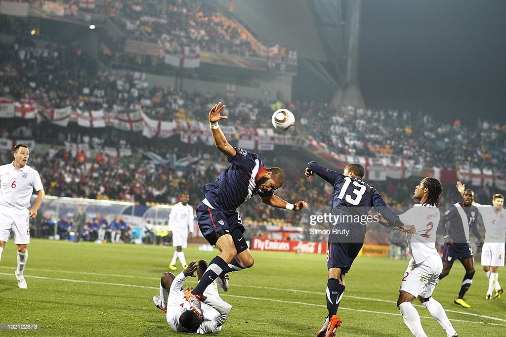 USA Oguchi Onyewu (5) in action, landing on England Emile Heskey (21) during Group C - Match 5 at Royal Bafokeng Stadium. Rustenburg, South Africa 6/12/2010