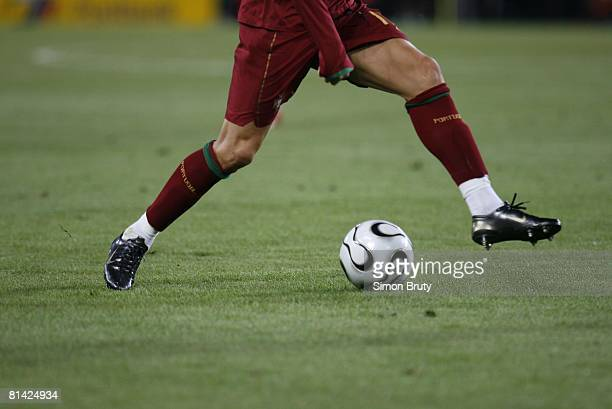Soccer World Cup View of legs of Portugal Cristiano Ronaldo in action vs Angola Cologne Germany 6/11/2006