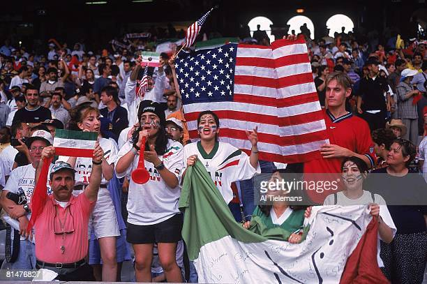 Soccer World Cup View of USA and Iran fans with flags in stands during game vs USA Lyon France 6/21/1998