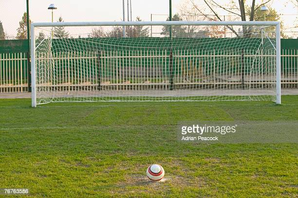 soccerball and a soccer goal - soccer goal stock pictures, royalty-free photos & images