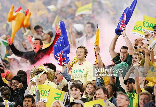 Socceroo fans celebrate a goal by Marco Bresciano during the second leg of the 2006 FIFA World Cup qualifying match between Australia and Uruguay at...