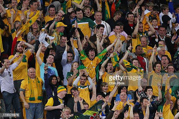 Socceroo fans celebrate a goal during the Asian Qualifying 2014 FIFA World Cup match between the Australian Socceroos and Thailand at Suncorp Stadium...