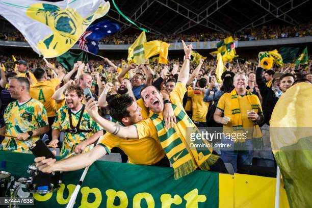 Socceroo fans celebrate after the teams win at the 2018 FIFA World Cup Qualifiers Leg 2 match between the Australian Socceroos and Honduras at ANZ...