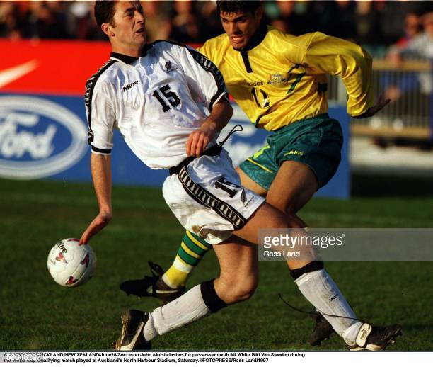 Socceroo John Aloisi clashes for possession with All White Riki Van Steeden during rthe World Cup Qualifying match played at Auckland's North Harbour...