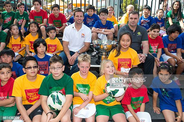 Socceroos Captain Lucas Neill and coach Ange Postecoglou pose with the Asia Cup trophy and a range of multicultural children during the AFC Asian Cup...