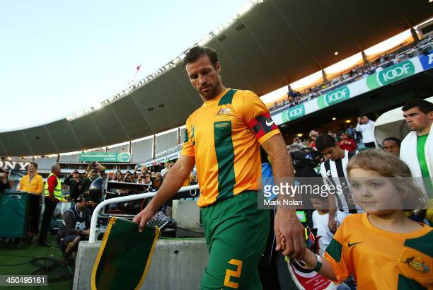 Socceroos captain Lucas Neill leads his team onto the feild during the international friendly match between the Australian Socceroos and Costa Rica...