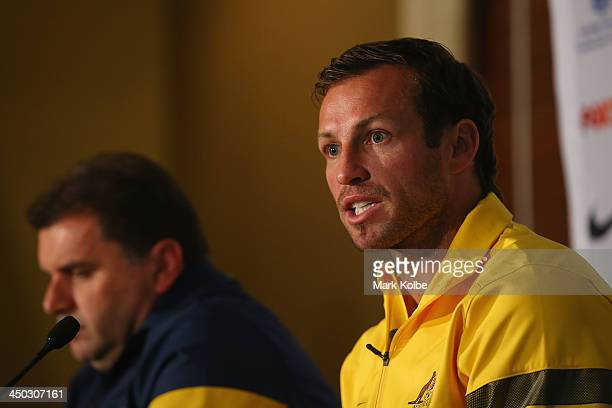 Socceroos captain Lucas Neill speaks to the media at an Australian Socceroos press conference at the Intercontinental Hotel on November 18 2013 in...