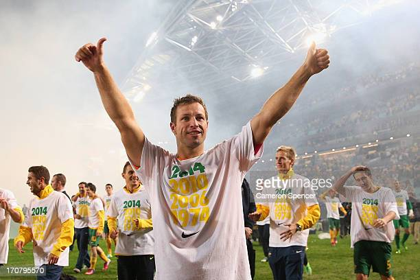 Socceroos captain Lucas Neill thanks fans after winning the FIFA 2014 World Cup Asian Qualifier match between the Australian Socceroos and Iraq at...