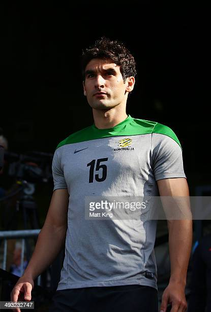Socceroos captain Mile Jedinak walks onto the field during an Australian Socceroos training session at WIN Jubilee Stadium on May 23 2014 in Sydney...
