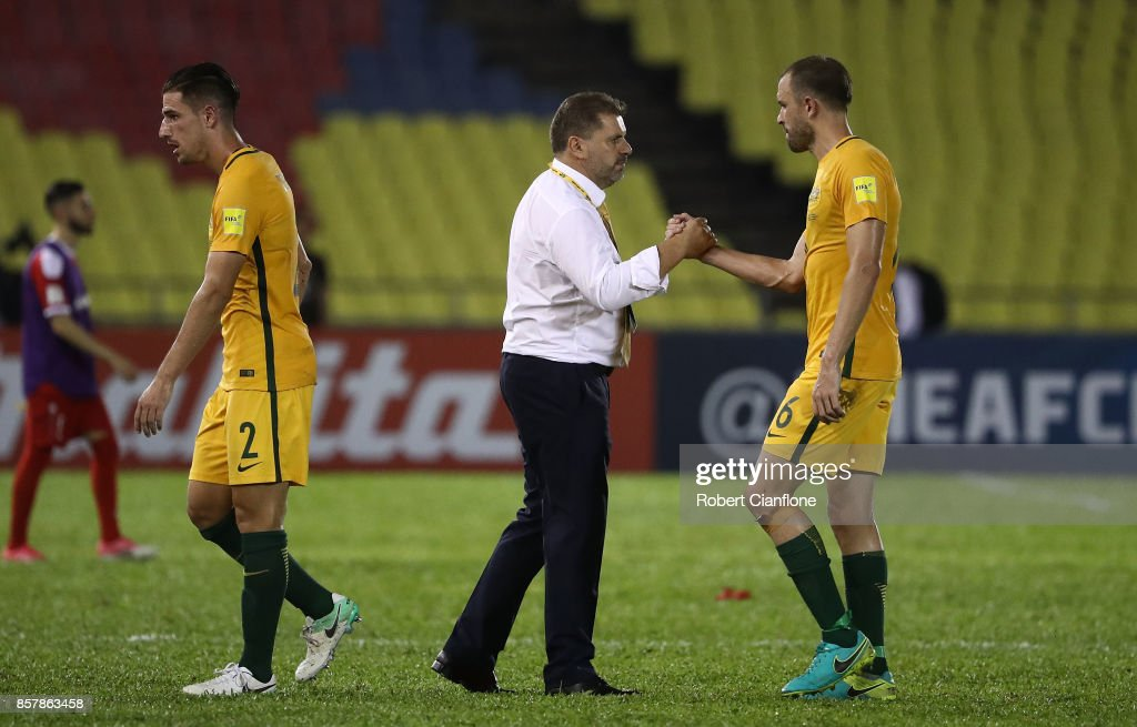 Socceroos coach Ange Postecoglou acknowledges his players after the 2018 FIFA World Cup Asian Playoff match between Syria and the Australia Socceroos at Hang Jebat Stadium on October 5, 2017 in Malacca, Malaysia.