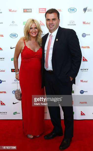 Socceroos coach Ange Postecoglou poses on the red carpet with his wife Georgia Postecoglou during the 2013 Australian Football Awards at Sydney...