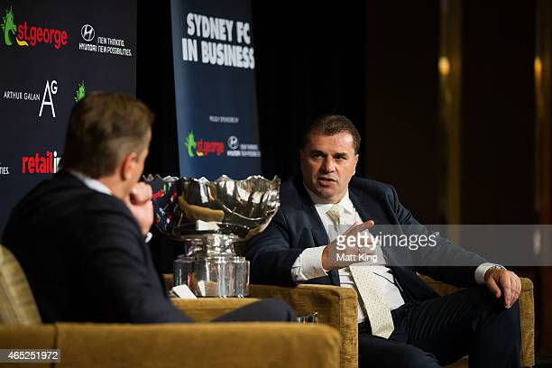 Socceroos coach Ange Postecoglou speaks to media personality Mark Bosnich during the Sydney FC In Business Lunch at Westin Hotel on March 5 2015 in...