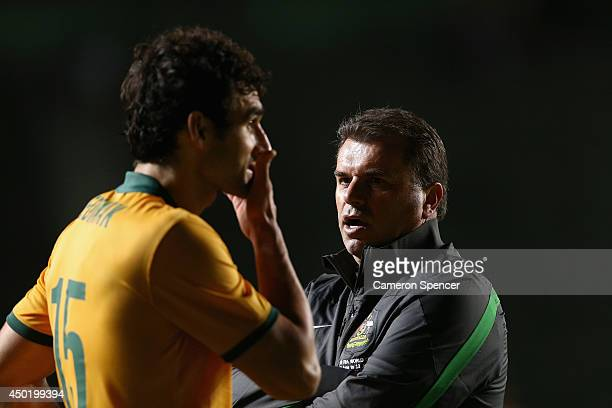 Socceroos coach Ange Postecoglou talks to Socceroos captain Mile Jedinak following the International Friendly match between Croatia and the...
