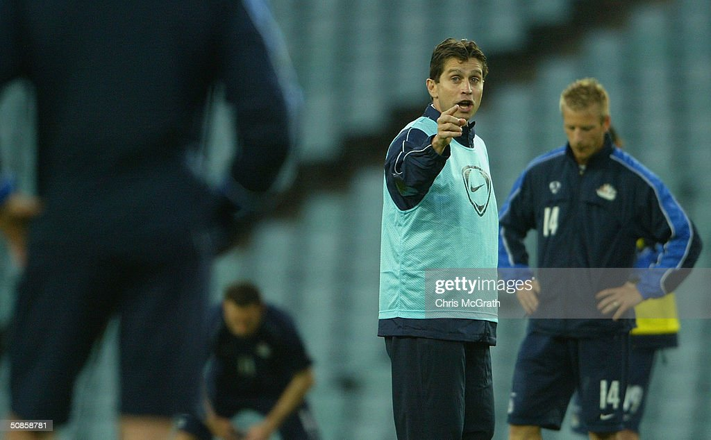Socceroos coach Frank Farina talks to his players during Australian Socceroos training held at Aussie Stadium, May 20, 2004 in Sydney Australia.