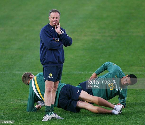Socceroos coach Graham Arnold watches over his team as Tim Cahill stretches in the background during the Socceroos training session at Telstra...