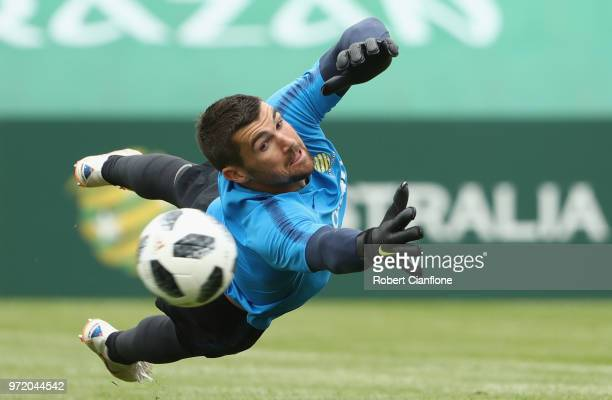 Socceroos goalkeeper Mathew Ryan dives for the ball during an Australia Socceroos training session ahead of the FIFA World Cup 2018 at Stadium...