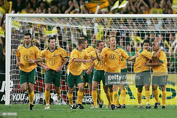 Socceroos players celebrate a goal by Marco Bresciano during the second leg of the 2006 FIFA World Cup qualifying match between Australia and Uruguay...