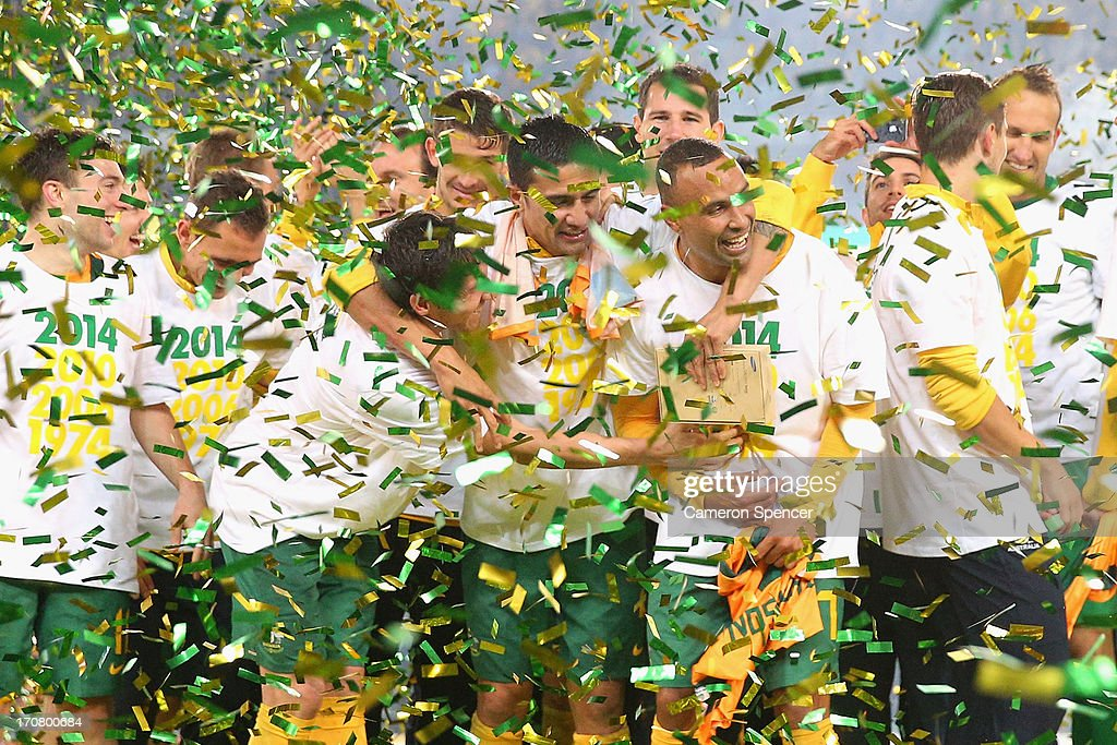 Socceroos players celebrate after winning the FIFA 2014 World Cup Asian Qualifier match between the Australian Socceroos and Iraq at ANZ Stadium on June 18, 2013 in Sydney, Australia.