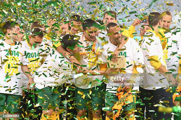 Socceroos players celebrate after winning the FIFA 2014 World Cup Asian Qualifier match between the Australian Socceroos and Iraq at ANZ Stadium on...