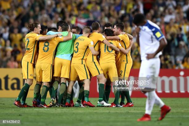 Socceroos players celebrate winning the 2018 FIFA World Cup Qualifiers Leg 2 match between the Australian Socceroos and Honduras at ANZ Stadium on...