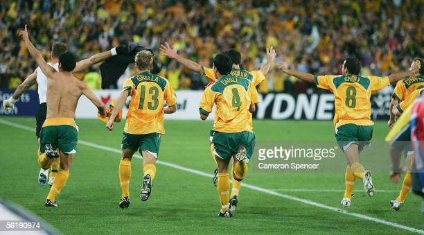 Socceroos players celebrate winning the second leg of the 2006 FIFA World Cup qualifying match between Australia and Uruguay at Telstra Stadium...