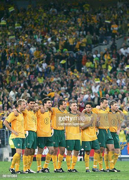 Socceroos players look on in the penalty shootout during the second leg of the 2006 FIFA World Cup qualifying match between Australia and Uruguay at...