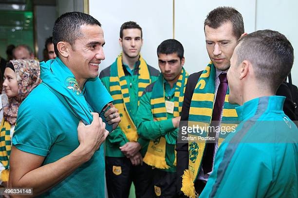 Socceroos Tim Cahill and Matt McKay chat with former Socceroo Brett Emerton during an Australian Socceroos visit to Parliament House on November 9...