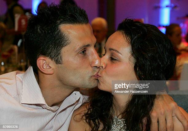 Soccerstar Hasan Salihamidzic of Munich and girlfriend Esther Copado kiss during the Bayern Munich champions party after the German Football...