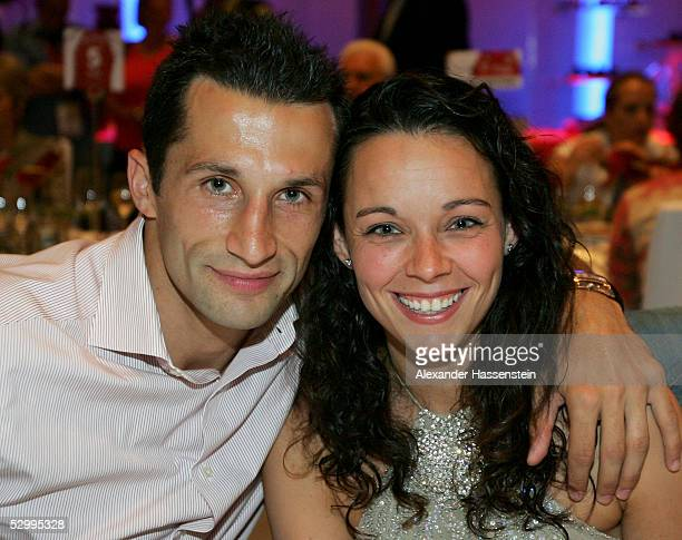 Soccerstar Hasan Salihamidzic of Munich and girlfriend Esther Copado pose during the Bayern Munich champions party after the German Football...