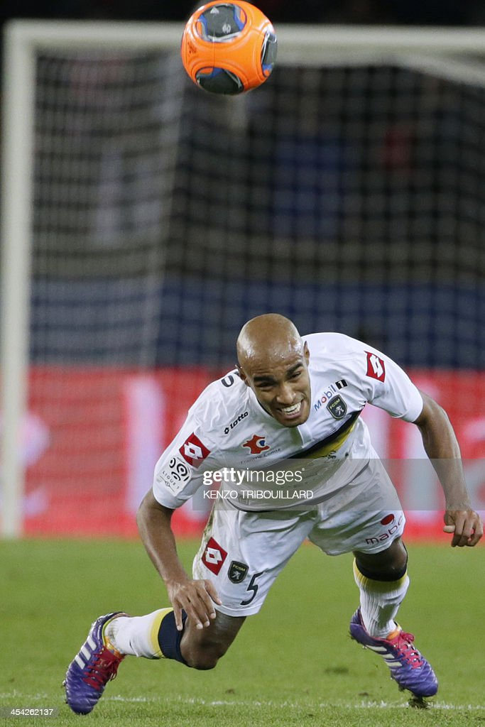 Sochaux' Brazilian midfielder Carlos Alberto Carlao heads the ball during the French L1 football match between Paris Saint-Germain and Sochaux at the Parc des Princes Stadium in Paris on December 7, 2013.