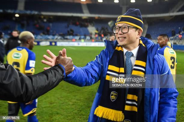 FC Sochaux' Chinese owner Wing Sang Li congratulates Sochaux' players at the end of the French Cup football match between Sochaux vs Amiens at the...