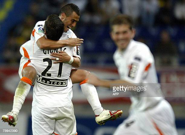 Lorient's French forward AndrePierre Gignac jubilates with Lorient's Algerian midfielder Rafik Saifi after scoring a goal during their French L1...