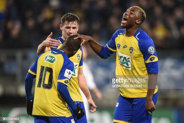 FC Sochaux French forward Aldo Kalulu is congratulated by his teammate French forward Yakou Meite after scoring a goal during the French Cup football...
