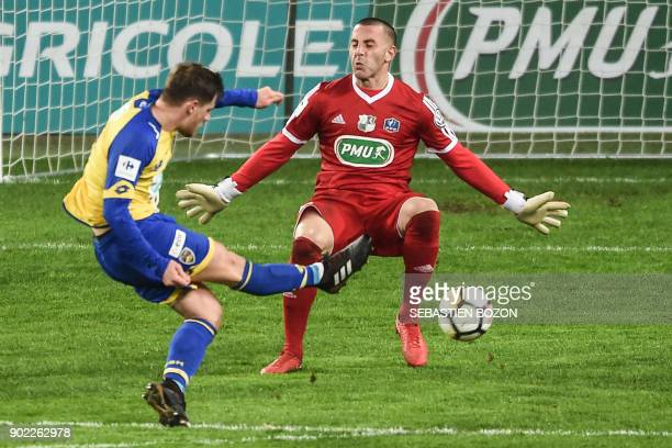 FC Sochaux French forward Thomas Robinet scores a goal despite of Amiens' French goalkeeper JeanChristophe Bouet during the French Cup football match...